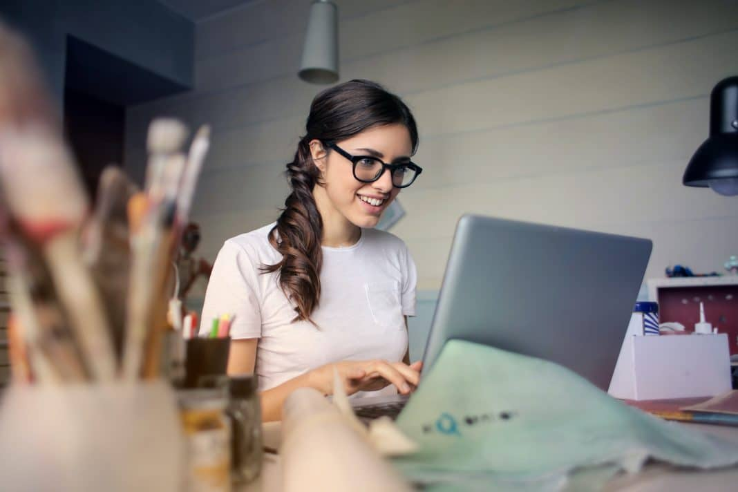 woman working at computer- getting ahead financially